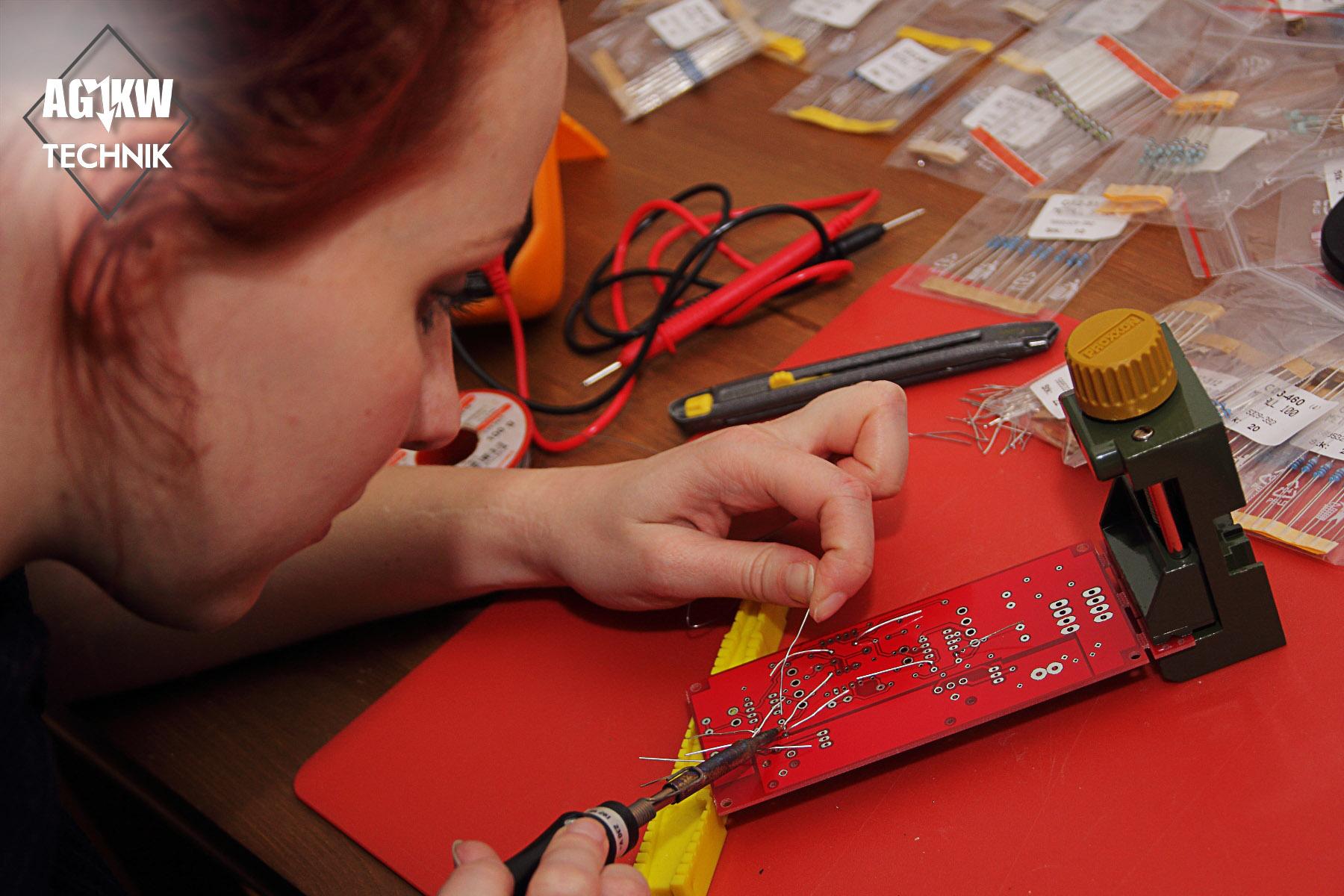 Evy at soldering Resistors